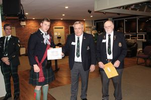 Bursary Award - Cpl Carlow, presented by Jack Amo and Ron Cullen of the Regimental Association.