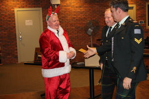 SANTA....AKA MCpl Byrne - along with the CO and RSM